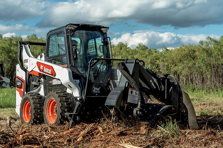 R-Series Skid-Steer Loader Using Powerful Hydraulics To Move Material On Construction Jobsite