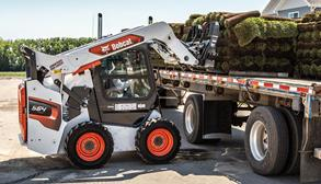Bobcat Skid-Steer Loader With Pallet Fork Attachment Loading Sod