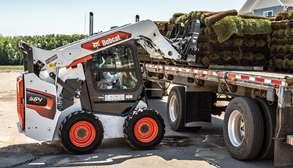 Bobcat Skid-Steer Loader With Pallet Fork Attachment Loading Sod