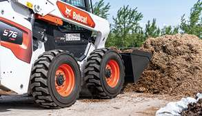 Bobcat Owner Using Skid-Steer Loader With Tires To Move Material