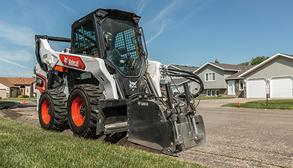 Bobcat Skid-Steer Loader With Planer Attachment