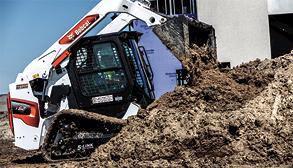 Operator Dumps Dirt Using Bucket Attachment On Bobcat R-Series Loader