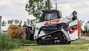 Bobcat Compact Track Loader with Grapple Attachment Moving Hay