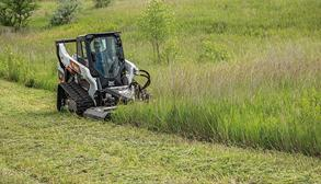 Bobcat Customer Clearing Brush With Brushcat Rotary Cutter