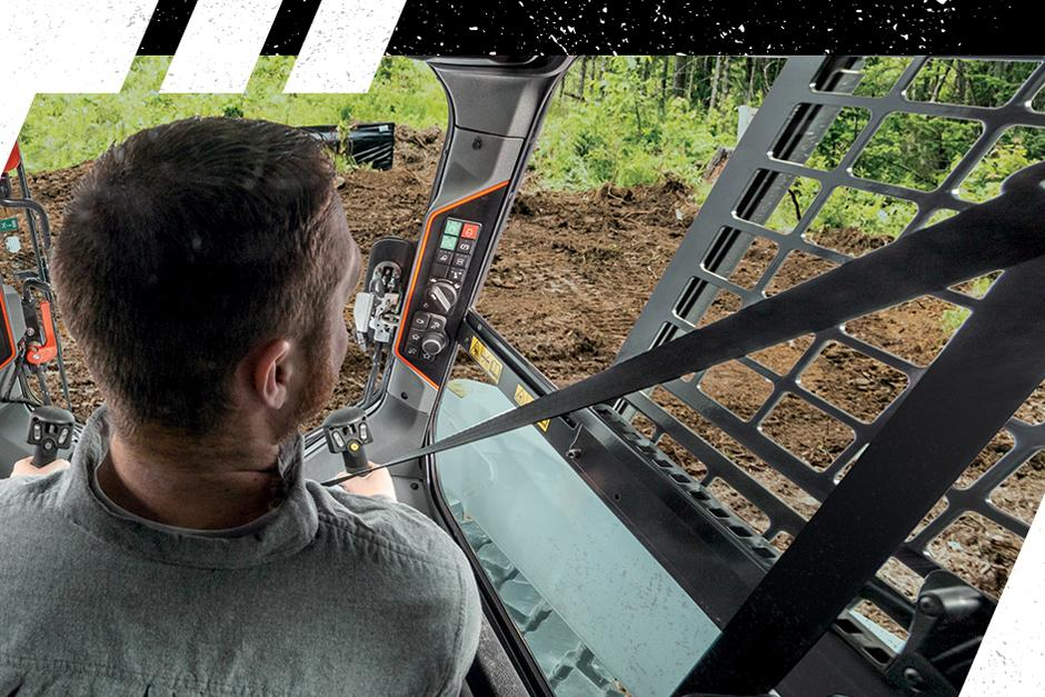 Bobcat Loader Operator Sitting In The Cab.