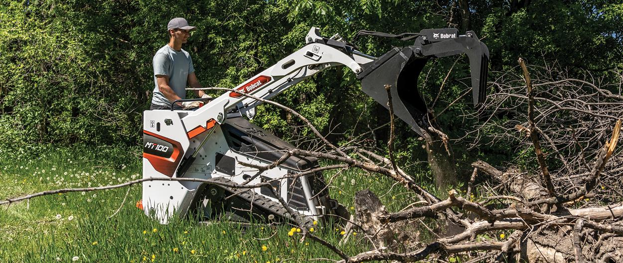 Homeowner Uses Mini Track Industrial Grapple Attachment To Move Large Pile Of Tree Branches