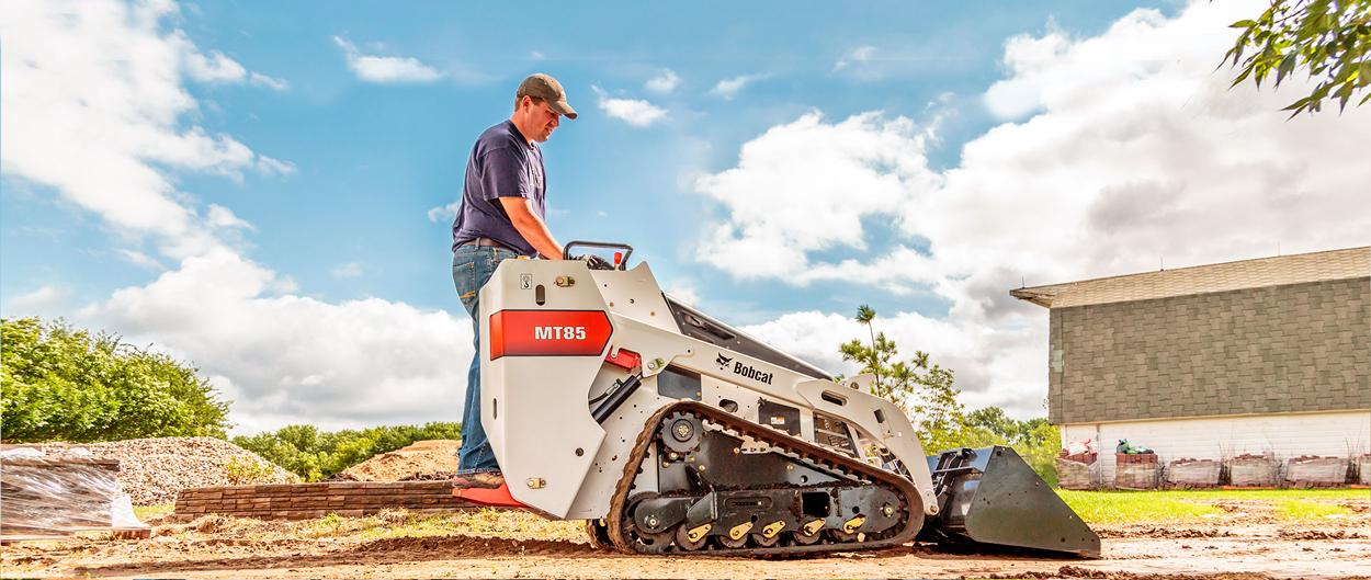The Bobcat MT85 mini track loader, carrying material across the jobsite.