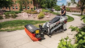 Landscaper Digs Into Large Pile Of Dirt With Bobcat MT85 Mini Skid Steer
