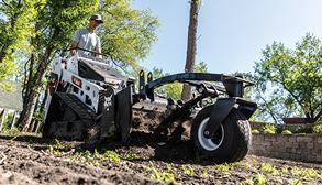 Farmer Uses Mini Track Loader With Soil Conditioner Attachment