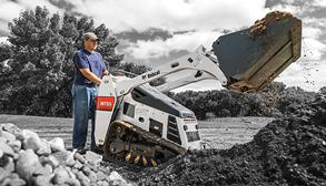 Bobcat Mini Track Loader Lifts Dirt on Landscaping Project