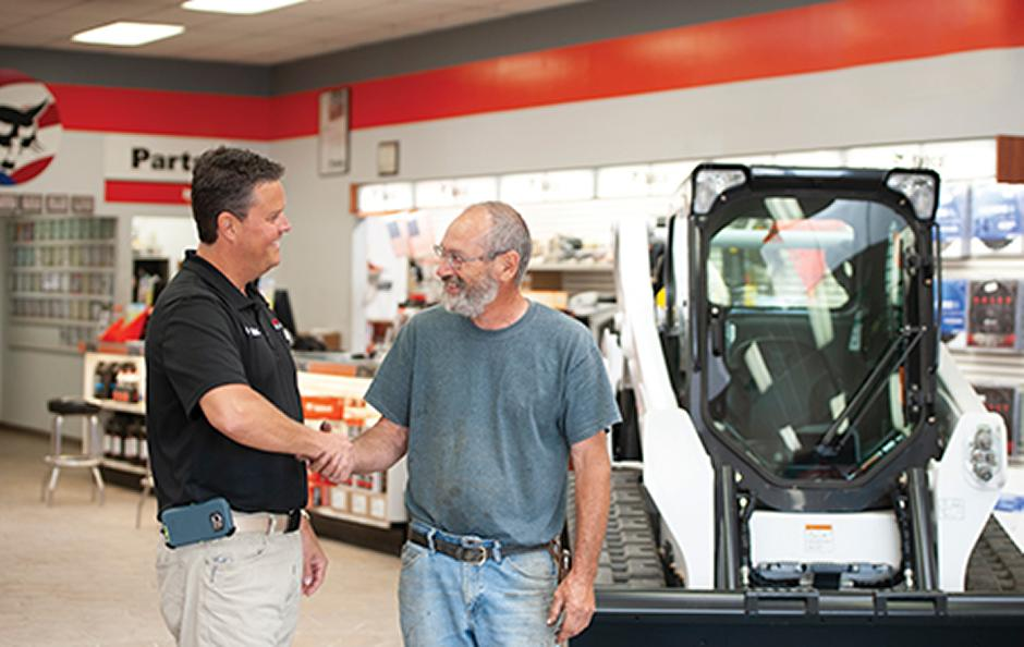 A Bobcat Company dealer shaking a customers hand
