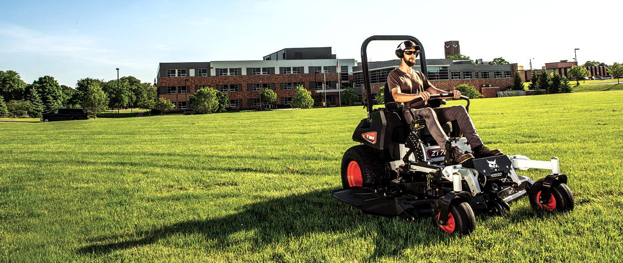 Operator Cuts Grass on Facility Grounds Using Bobcat ZT7000 Zero-Turn Mower