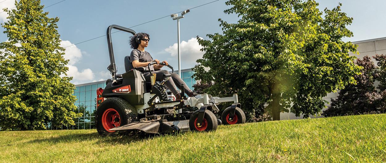 Operator Uses Zero-Turn Mower to Cut Grass