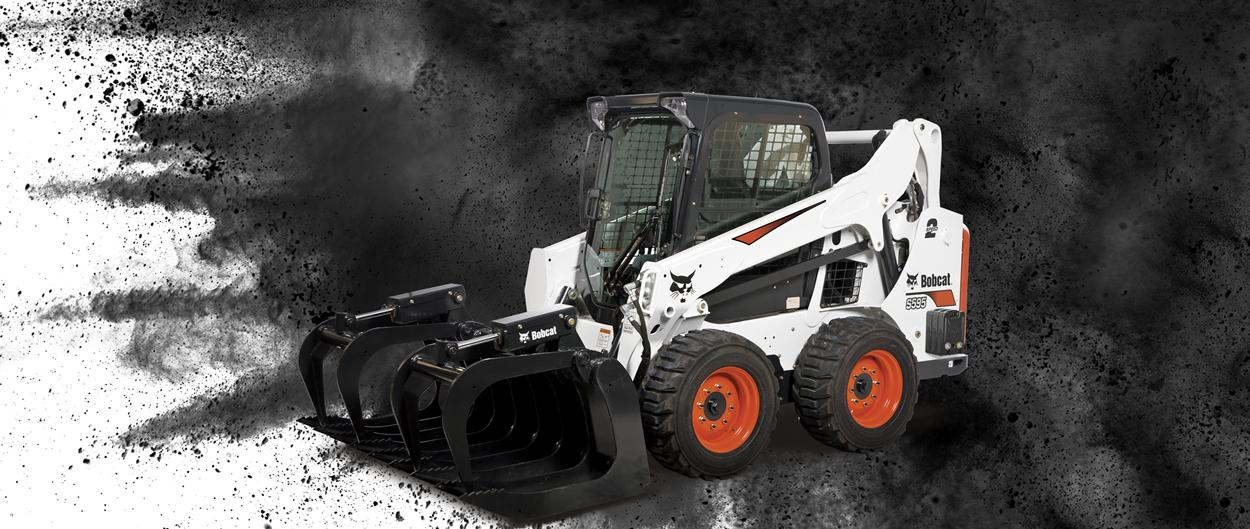 Bobcat S595 skid-steer loader and grapple attachment.