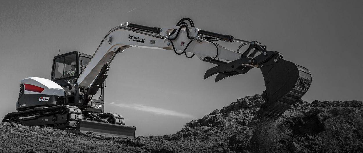 Bobcat E85 excavator and bucket attachment.