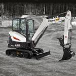 Bobcat E32 compact excavator in farm setting