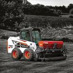 Bobcat S550 skid-steer loader in farm setting