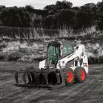 Bobcat S570 skid-steer loader in farm setting