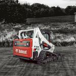 Bobcat T595 compact track loader in farm setting