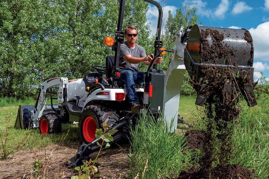 Bobcat Compact Tractor Digging With Backhoe Implement