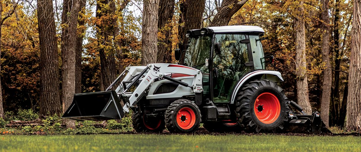 Bobcat CT5550 Compact Tractor With Front-End Loader And 3-Point Tiller Implement Cultivating Land