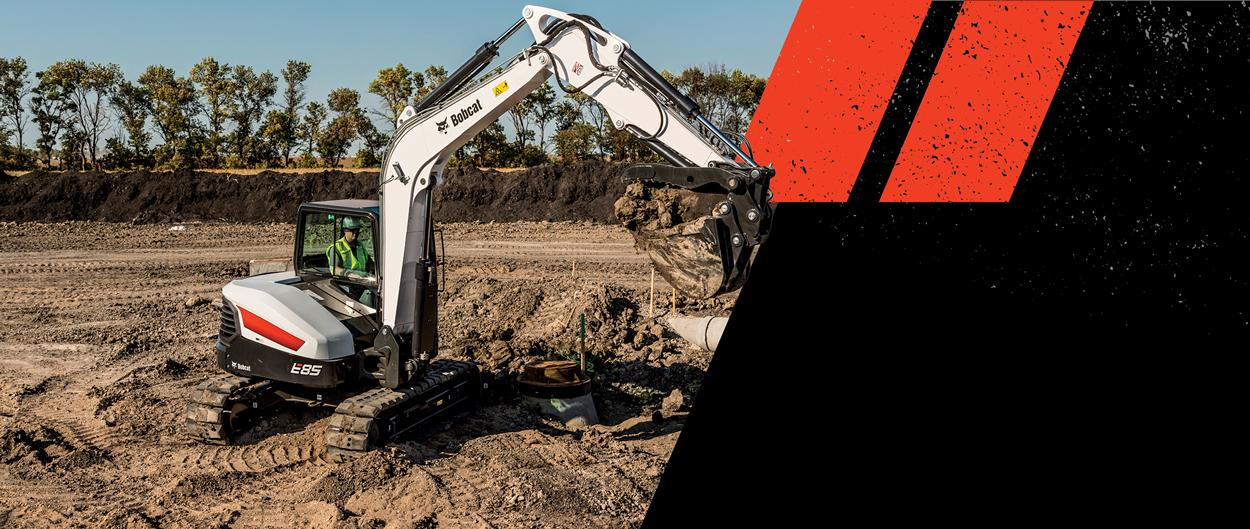 Graphic Featuring Bobcat E85 Compact Excavator With Bucket And Clamp Attachment At Work On Jobsite