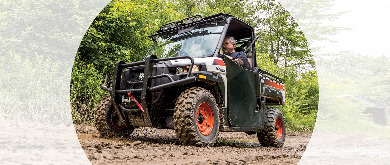 Bobcat 3400 utility vehicle (UTV) in a muddy forest