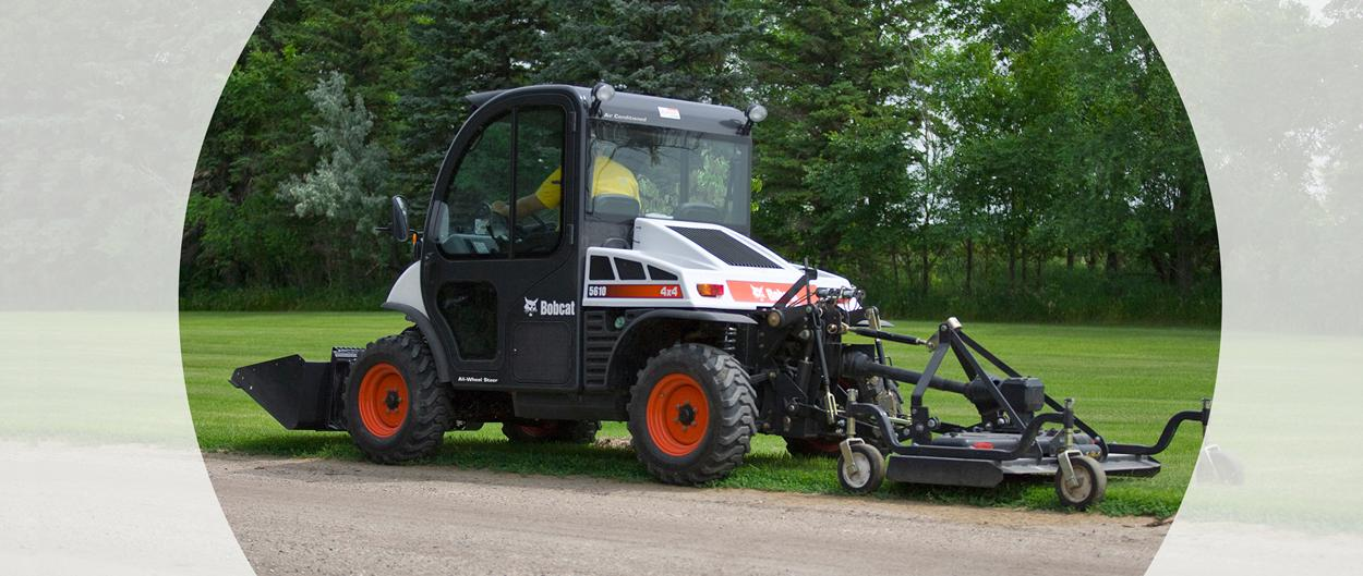 Bobcat Toolcat 5610 utility work machine with a bucket and mower attachment.