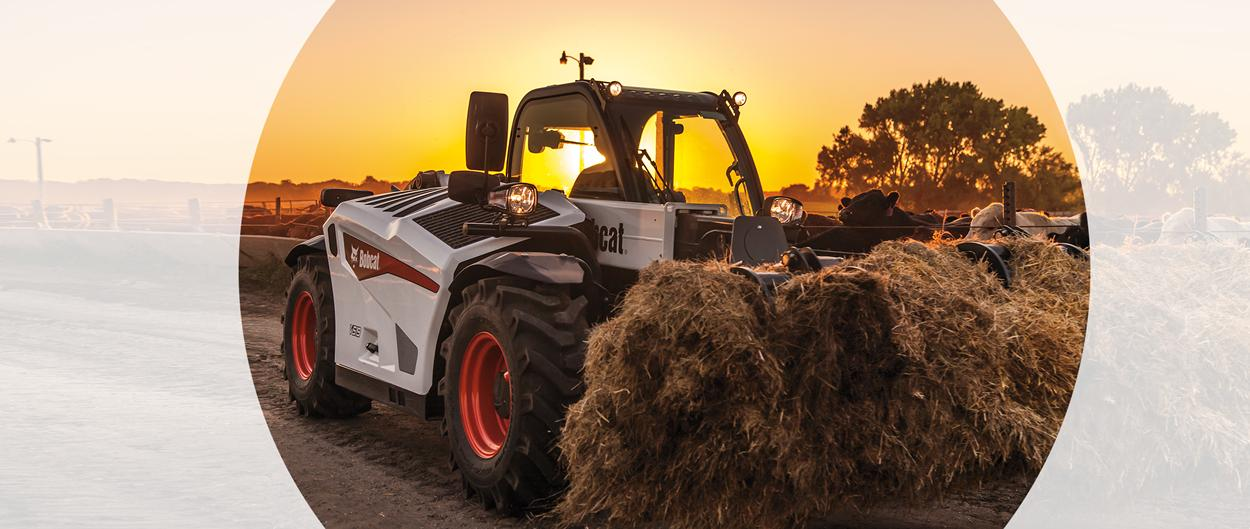 Bobcat V519 Telescopic Tool Carrier With Telehandler Grapple Attachment Lifts Shredded Hay