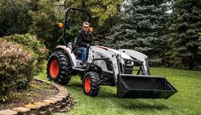 Bobcat CT2025 Compact Tractor Driving On Grass