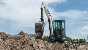 Bobcat E35 Compact Excavator Moving Dirt On Construction Site.