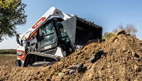 Bobcat T66 Compact Track Loader Dumping Dirt.