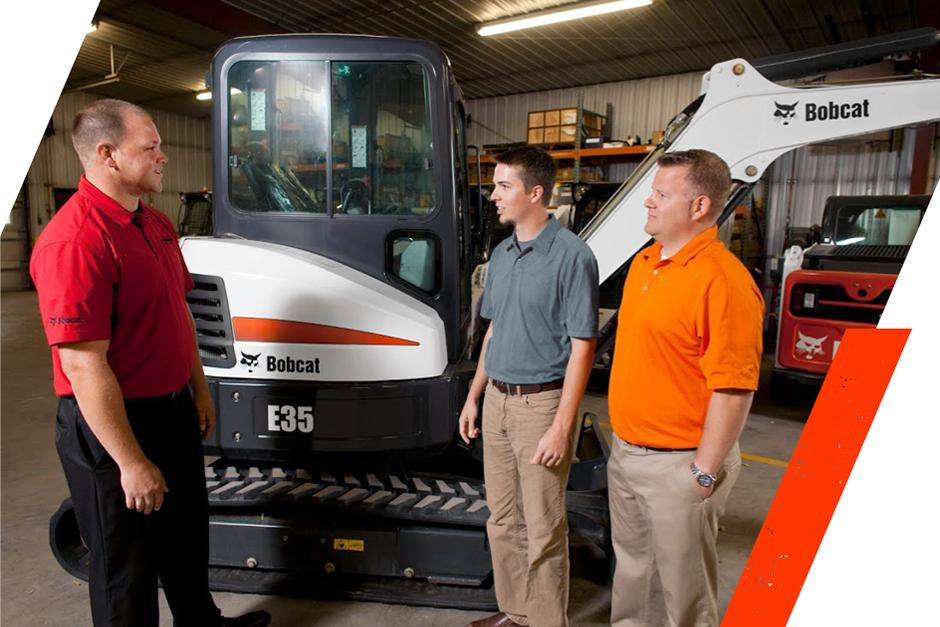 Students At Bobcat Bootcamp Examine An E35 Compact Excavator With A Member Of The Bobcat Team