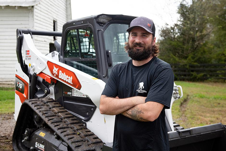 Veteran Standing Next To His New Bobcat T76 Compact Track Loader
