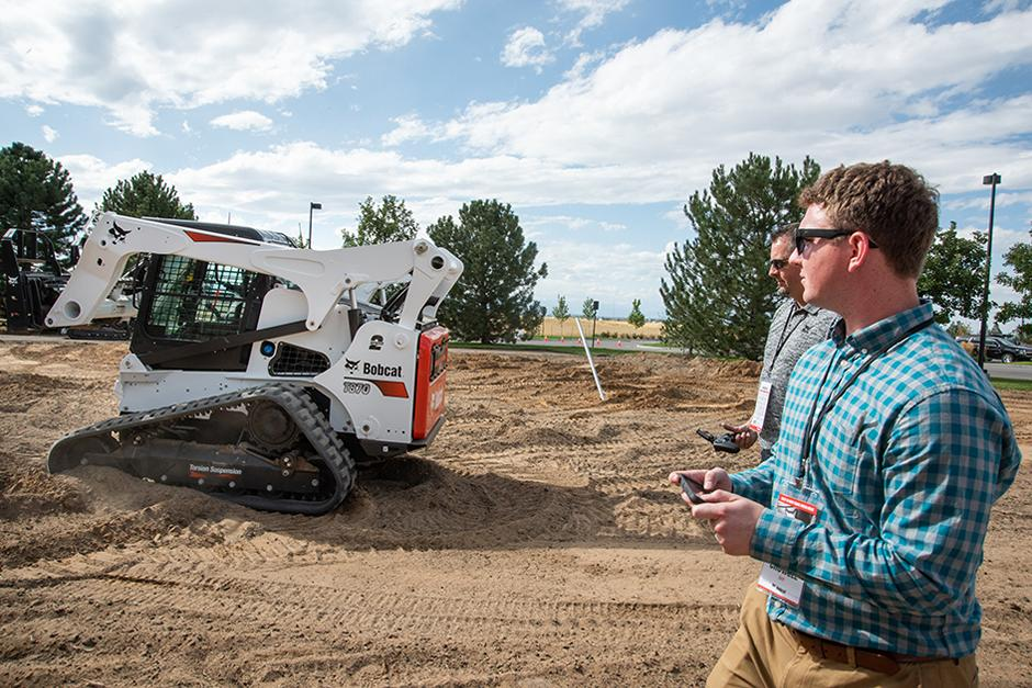 Bobcat Compact Track Loader Being Remote Controlled Through Cell Phone