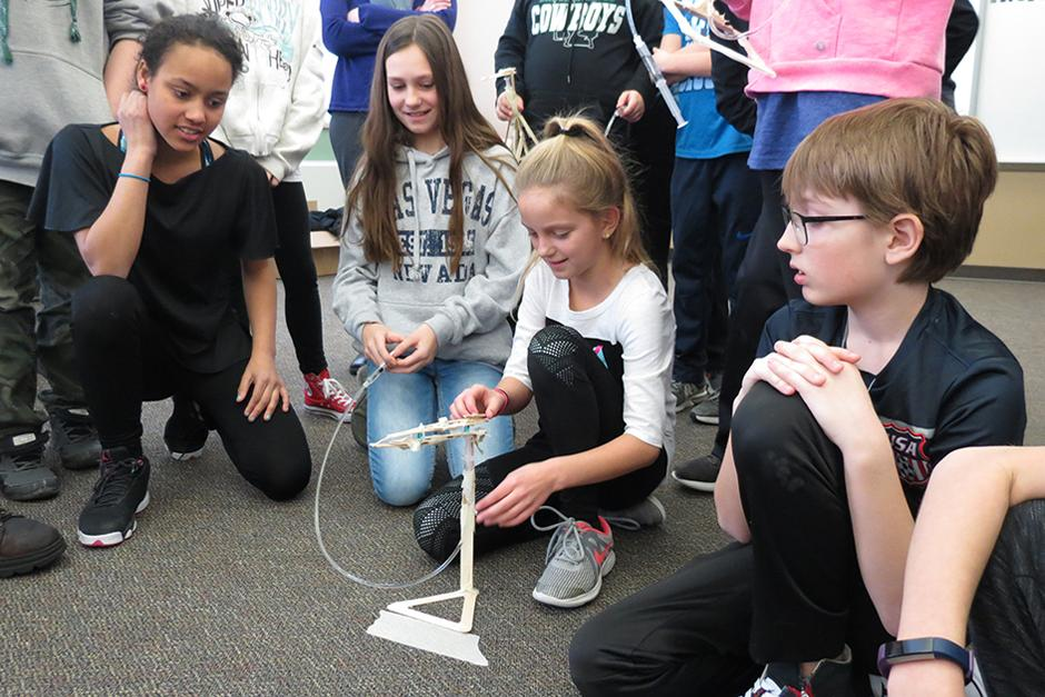 Bobcat Company Employees Volunteering in Middle School STEM Program