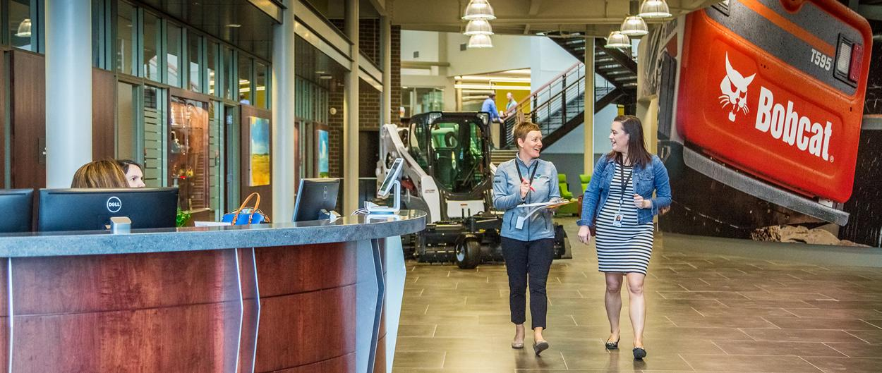 Bobcat Employees Walking Though Grand Entrance at West Fargo Headquarters