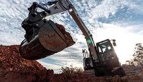 Bobcat Mini Excavator Breaking Ground On New Jobsite With Bucket Attachment