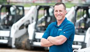 Bobcat Dealer Poses For A Photo In Front Of His Fleet Of Compact Loaders