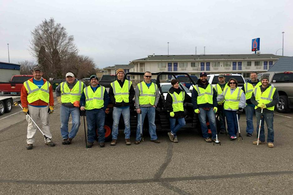 Bobcat employees in Bismarck, North Dakota get ready to pick up litter during Doosan Day of Community Service.