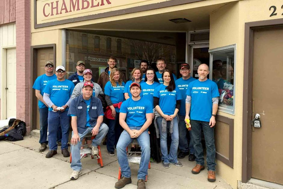 Employee volunteers from Litchfield, Minnesota gathered to clean windows during Doosan Day of Community Service