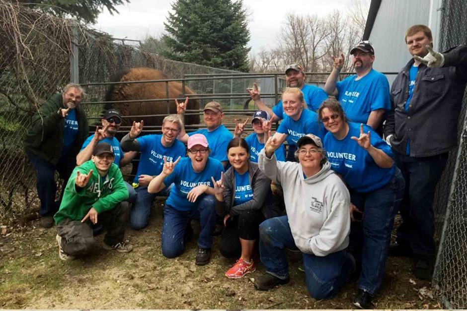 Employee Volunteers From Litchfield, Minnesota, Gathered To Clean Windows During Doosan Day of Community Service