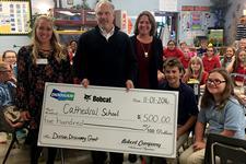 Doosan Bobcat presents a Doosan Discovery grant to a local school.