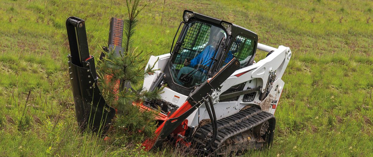 Bobcat T750 compact track loader with tree spade attachment.
