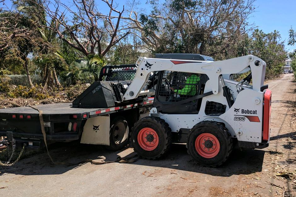 Bobcat Skid-Steer Loader With Bucket Attachment During Hurricane Relief