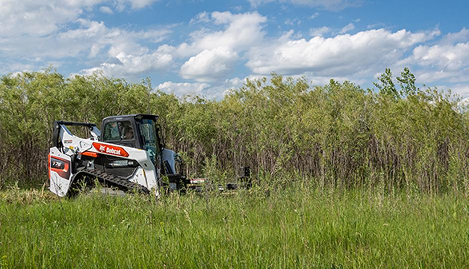 Operator Using Bobcat Compact Track Loader