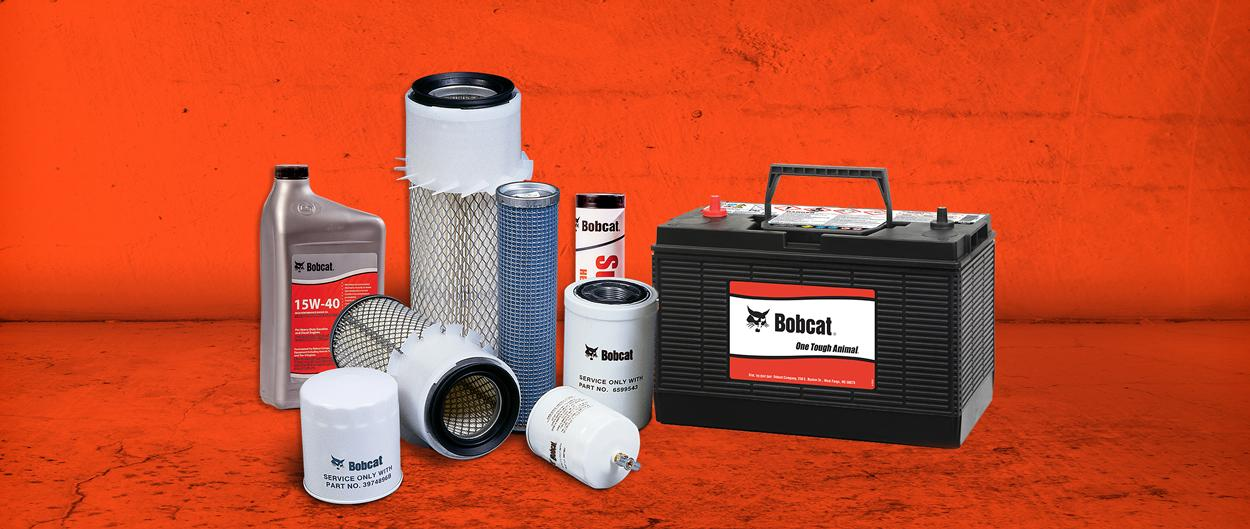 Parts for Bobcat machines, including oil, filters, grease and a battery.