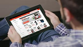 Bobcat Customer Using A Tablet To Shop For UTV Parts Online