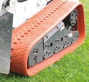 Non-marking turf pattern tracks on a Bobcat loader