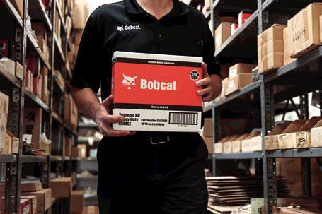 Bobcat Employee Carries Box Of Bobcat Genuine Parts Through Warehouse
